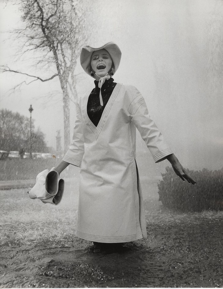 Jill Kennington wearing white PVC rain tunic and hat. Photograph by John Cowan, 1963 Courtesy of Fashion Museum Bath/Image © John Cowan Archive