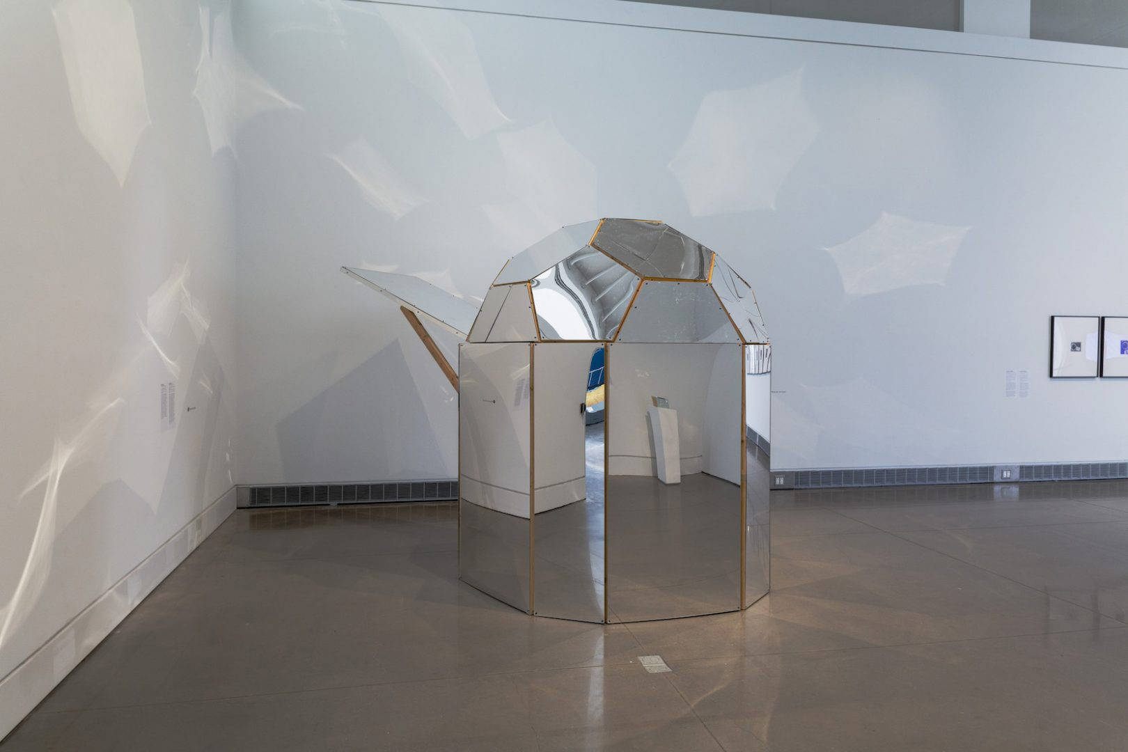 Beatriz Cortez, The Cosmos (Spaceship), 2015. Wood, acrylic mirror, sound installation. Installation view at the Queens Museum, New York. Courtesy of the artist and Commonwealth and Council. Photo: Hai Zhang.