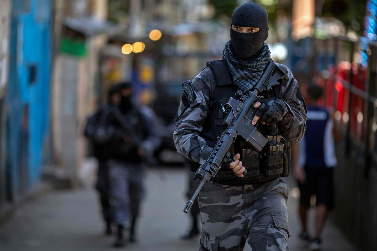 Members of the Brazilian Military Police special unit Choque, patrol during an operation in the Rocinha favela in Rio de Janeiro, Brazil. Photo: AFP