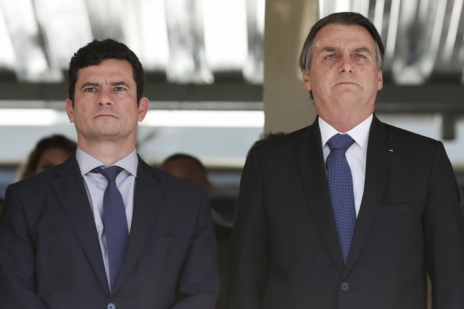 Brazil's President Jair Bolsonaro, right, and Justice Minister Sergio Moro attend a military ceremony in Brasilia, Brazil, 2019.  (Marcos Correa/Brazil's Presidential Press Office via AP)