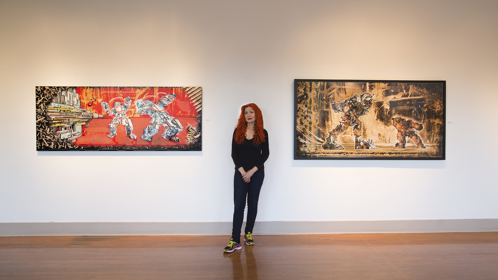 "Marjan Moghaddam with her digital Paintings ""Shot in Iran"" and ""David and Goliath"", (both 2012) at Main Line Art Center in 2015"